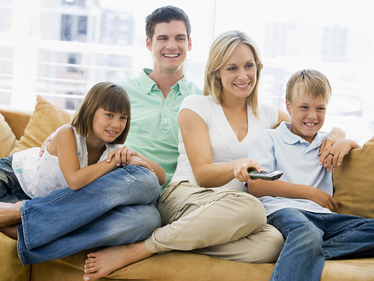 https://www.schaiblesplumbing.com/wp-content/uploads/2020/12/family-sitting-in-living-room-with-remote-control-5930802-small.jpg